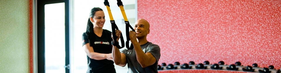 Trainer Helping with TRX